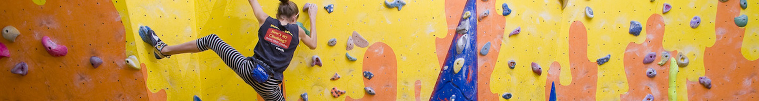 Girl on a climbing wall